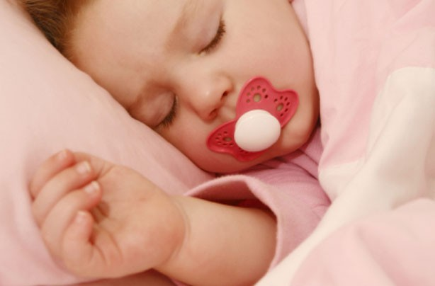 Baby asleep with dummy