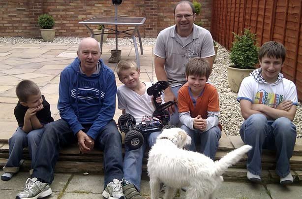 Sonia's boys with their dad and grandad