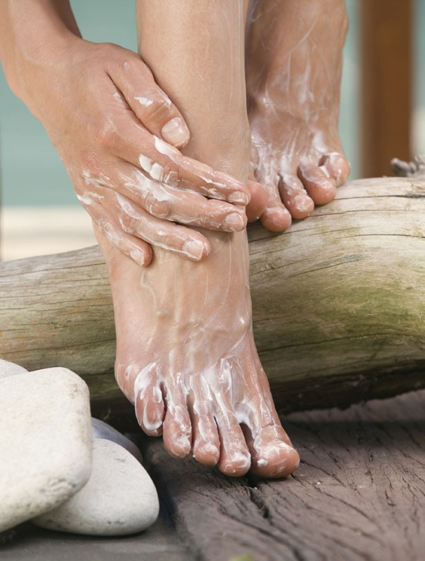 Woman exfoliating feet