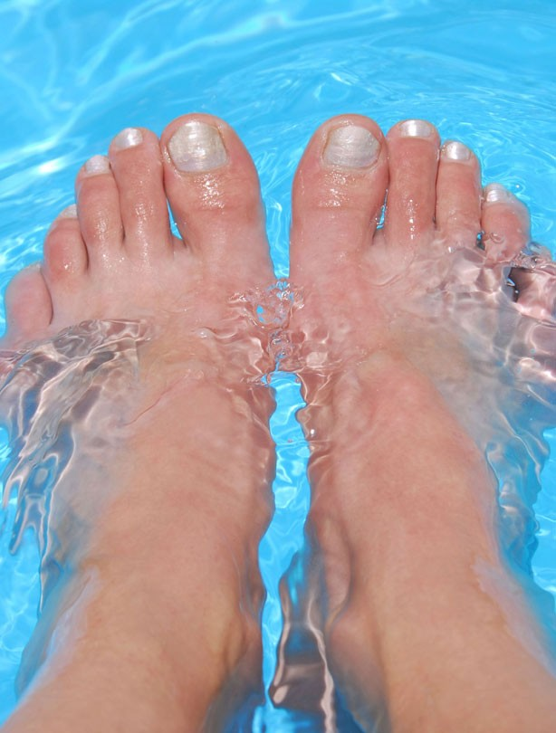 woman with feet in pool