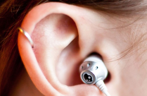 Teenager with cartilage pierced on her ear