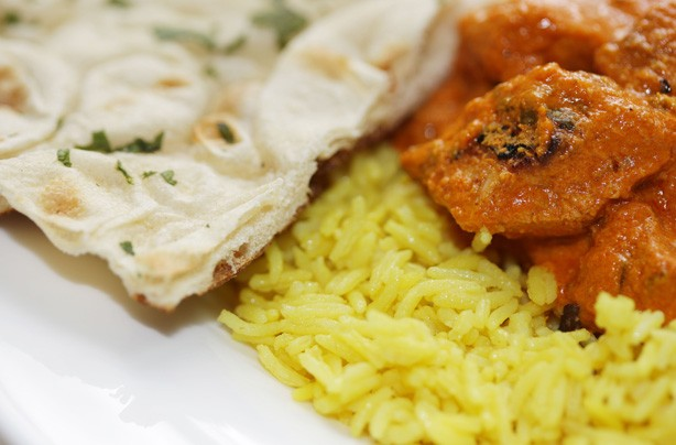 Chicken tikka masala with rice and naan bread