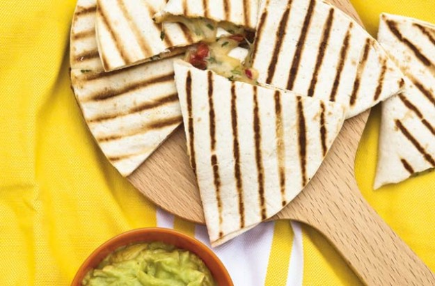 These crispy grilled tortillas are sandwiched with a tasty filling of cheese, tomato and coriander. An easy snack to cook on a barbecue grill or griddle.