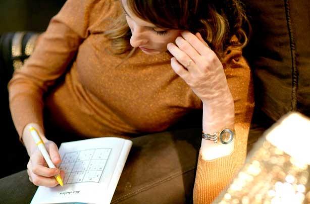 Woman doing Sudoku