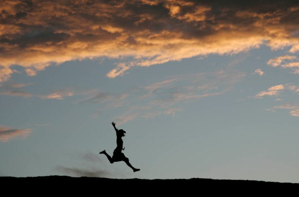 Woman jumping for joy photo