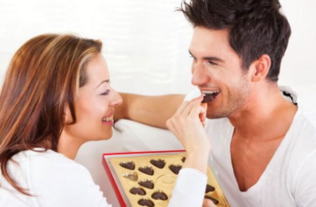 Couple feeding each other chocolates