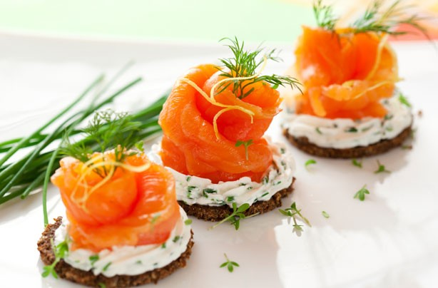 Smoked salmon roses on rye toast