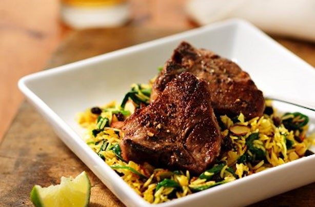 Fruity lamb chops with spinach and saffron rice