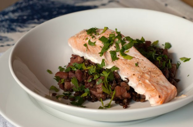 Baked salmon with pancetta and lentils