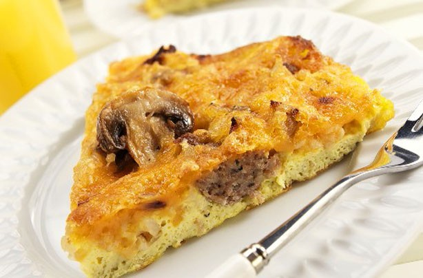 Deep pan cheesy and sausage omelette