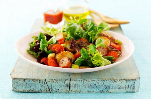 Sausage, roast new potato and tomato salad
