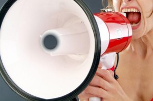 Woman shouting into megaphone
