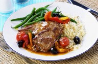 Pork steaks with peppers and olives