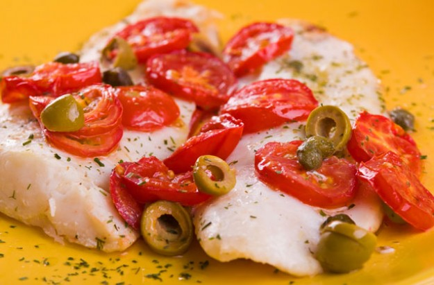 Oven baked fish with tomatoes and olives