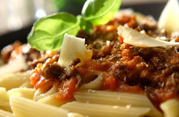 Penne Bolognese with cubetti di pancetta
