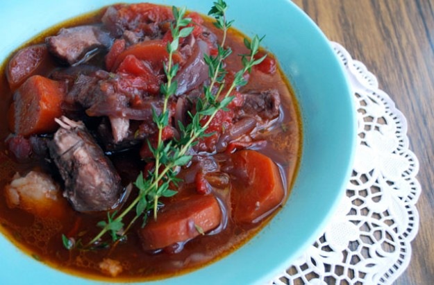 Slow-cooked lamb shanks in red wine sauce