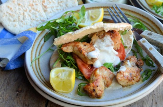 Cajun chicken kebabs with wraps, dip and salad