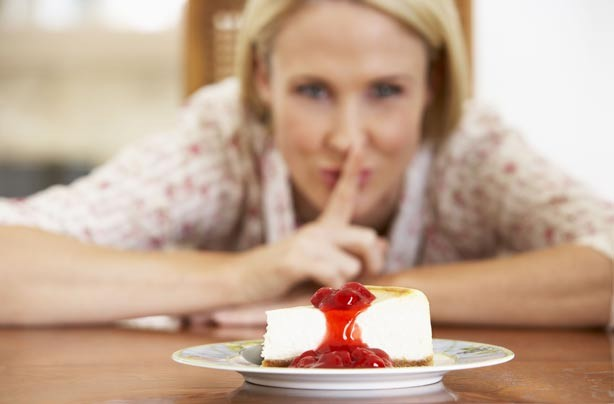 Woman tempted by cheescake
