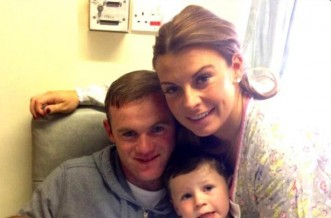 Wayne and Coleen Rooney with Kai and baby Klay