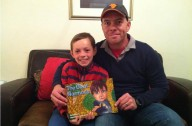 David Bennet with his son, Oliver, and the book, The Giant Normous