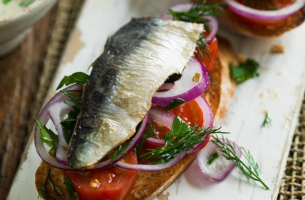 Sardines and salad on toast