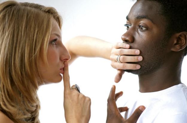 Couple whispering secret