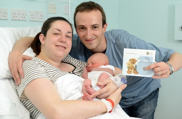 Marc and Beverley Miell with their newborn, born within minutes of the royal baby