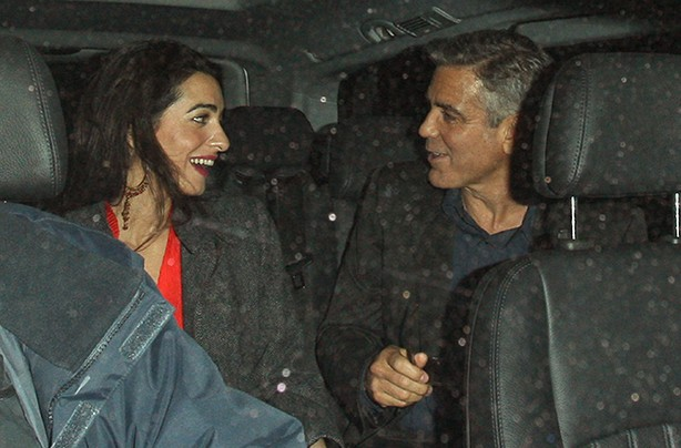 George Clooney and Amal Alamuddin in the back of a taxi