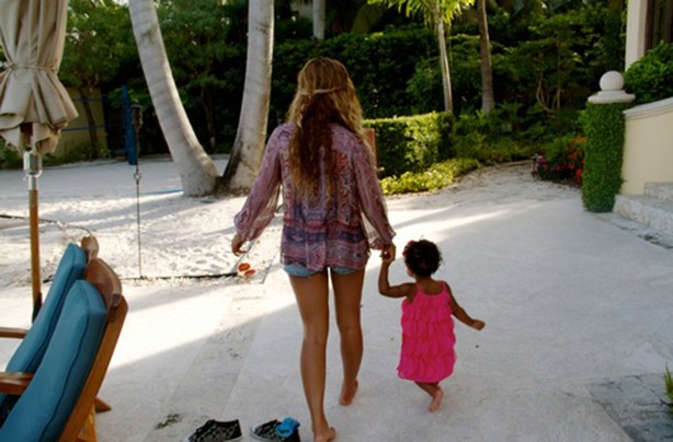 Beyonce holding Blue Ivy's hand as she walks