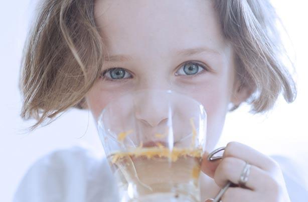 Little girl drinking tea