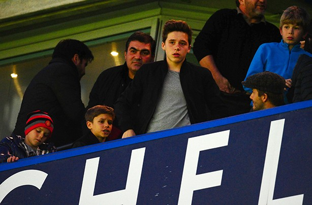 David Beckham watching Manchester United with sons