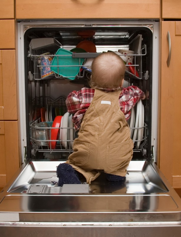 Child climbing in dishwasher