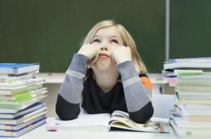 School girl fed up in class