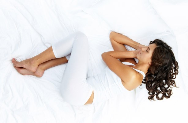 Woman sleeping in white pyjamas