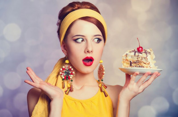 Woman eating dessert, annoying dieters