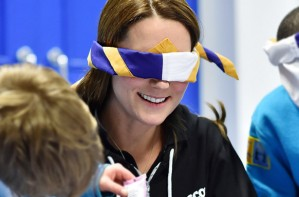 Kate Middleton wearing a hoody and blindfold