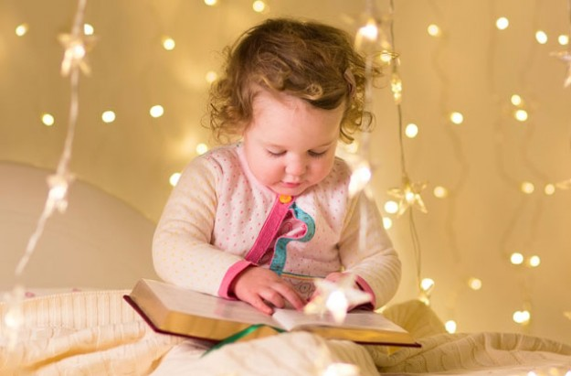 Little girl reading story book