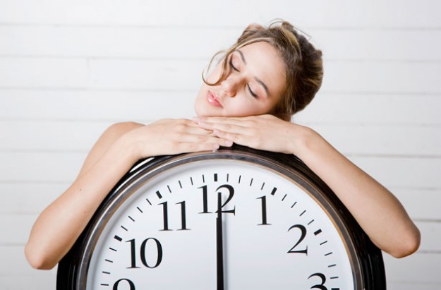 Woman asleep on a clock
