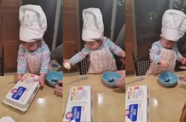 Toddler cracking an egg