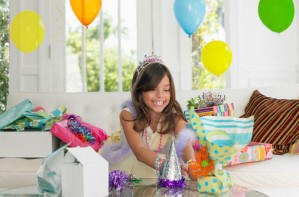 Child opening birthday presents