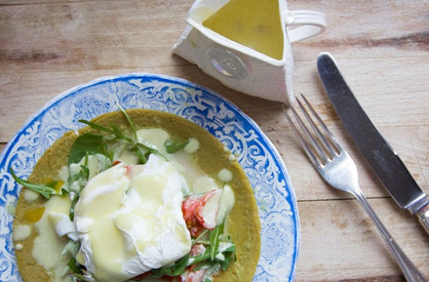 Poached eggs with tomato and rocket on a buckwheat pancake