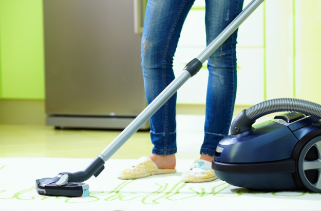 Woman vacuuming, hoovering