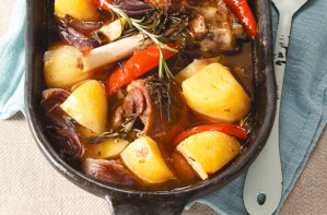 Pot-roasted lamb with potatoes and rosemary