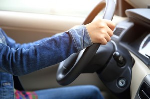 Woman driving, steering wheel