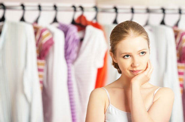 Woman in front of clothes, wardrobe, dressing