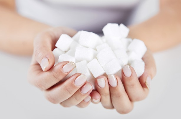 Woman holding sugar cubes