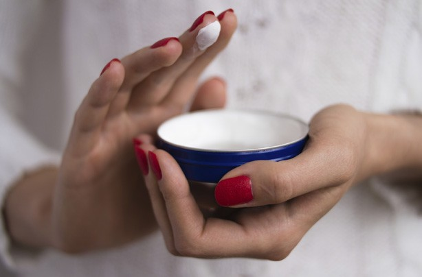 Woman applying cream, moisturiser, how to get rid of cellulite