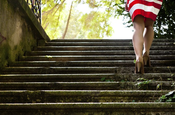 Woman walking up stairs, how to get rid of cellulite