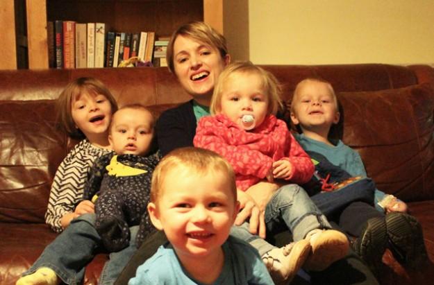 Gillian Harvey and family, bottle feeding