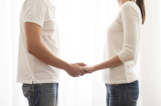 Couple holding hands, boosting male fertility